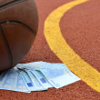 Basketball and euro money — Stock Photo