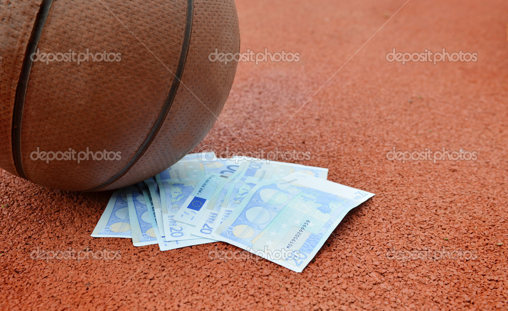 Basketball and Euros money on a court. Concept for sports economy — Stock Photo #12235910