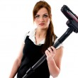 Beautiful brunette woman holding a vacuum cleaner — Stock Photo
