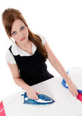 Nervous woman ironing clothes on ironing board — 图库照片