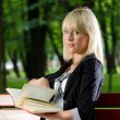 Reading in park — Stock Photo #11343941