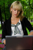 The woman with laptop on outdoor — Stock Photo