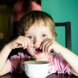 Scared little boy eating — Stock Photo