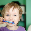 Little boy brushing teeth — Stock Photo