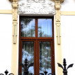 Old house decorated window — Stock Photo #11058004