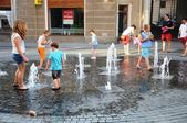 Kids playing with water — Stock Photo