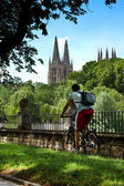 Urban Cyclist with Burgos Gothic Cathedral in Background. Spain — Stock Photo