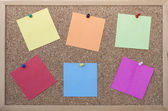 Cork board with post its — Stock Photo