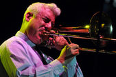 Trombonist from Pink Martini band performs live on the stage — Stock Photo