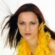 Naked woman with yellow feathers scarf — Stock Photo