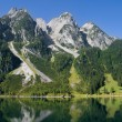 Stock Photo: Mountains bordering lake