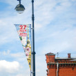Street lights with banners of The Day of the City Announcement. — Stock Photo