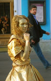Young actress in golden dress playing N. Goncharova — Stock Photo