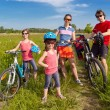 Happy family on bikes, cycling outdoors — Stock Photo