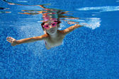 Happy underwater child in swimming pool — Stock Photo