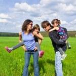 Happy family outdoors having fun — Stock Photo #10835623