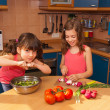 Kids cooking salad at kitchen — Stock Photo