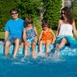 Family summer vacation, fun near swimming pool — Stock Photo