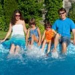 Family summer vacation, fun near swimming pool — Stock Photo #11001900