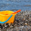 Beach toys near sea — Stock Photo