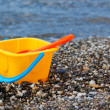 Stock Photo: Beach toys near sea