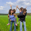 Happy family outdoors having fun — Stock Photo