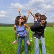 Royalty-Free Stock Photo: Happy family outdoors having fun
