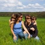 Happy family outdoors having fun — Stock Photo