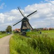 Traditional Dutch windmill near Volendam, Holland - Stock Photo