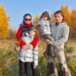 Happy family in autumn park — Stock Photo #11004585