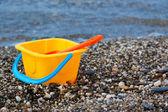 Beach toys near sea — Stock Photo