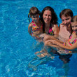 Royalty-Free Stock Photo: Happy family with two kids in swimming pool
