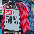 Sale signs in a market stand — Stock Photo