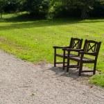 Beautiful garden park wooden chairs seating corner — Stock Photo