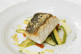 Hake roasted with vegetables — Stock Photo