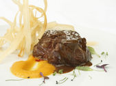 Sirloin of calf roast with cream of sweet potato and fried yucca — Stock Photo