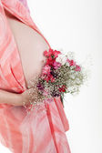 Pregnant woman's belly with flowers — Stockfoto