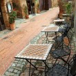 Garden furniture on italian narrow street i — Stock Photo