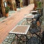 Garden furniture on italian narrow street i — Stock Photo