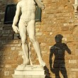 Michelangelo's David sculpture in sunset light. - Foto Stock