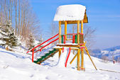Playground covered with snow in the winter in Polish mountains, Zawoja, Poland — Stock Photo