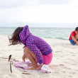 Children Playing in the Sand at the Beach - Stock Photo