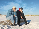 Two Bored Retired Men Seated at the Beach — Stock Photo