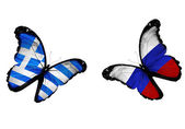 Concept - two butterflies with Greek and Russian flags flying — Stock Photo