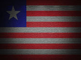 Liberia flag wall, abstract grunge background — Stock Photo