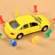 Toy car and push pin — Stock Photo #11916340
