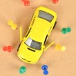 Toy car and push pin — Stock Photo #11916344