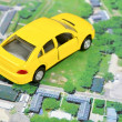 Satellite images and toy car — Stock Photo #11916351