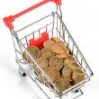 Coins in shopping cart — Stockfoto