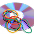 Foto Stock: Rubber bands and DVD
